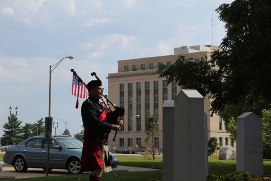 """Ron Husted played """"Amazing Grace"""" on the bagpipes for a silent audience during a commemoration of the signing of the armistice to end the Korean War on Saturday, July 27, 2019, near the State Capitol Building in Des Moines."""