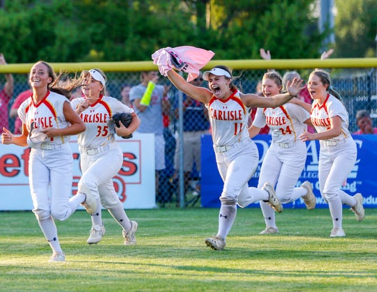 Carlisle celebrates after winning the 4A state championship softball game against North Scott in Ft. Dodge Friday, July 26, 2019.