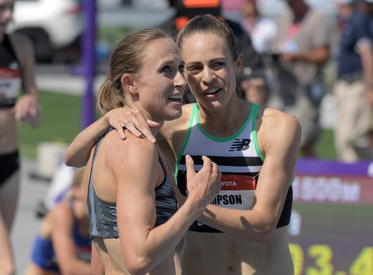 Shelby Houlihan (left) and Jenny Simpson embrace after placing first and second in the women's 1,500 meters in 4:03.18 and 4:03.41, respectively, during the USATF Championships at Drake Stadium on Saturday, July 27, 2019, in Des Moines.