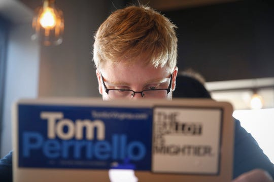 A member of democratic presidential candidate hopeful Joe Biden's Iowa campaign team works from a coffee shop on Saturday, July 19, 2019, in Iowa City.