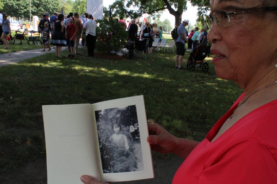 Anestatia Walsh, 76, holds a nearly 70-year-old photo from when she lived in South Korea. Walsh fled her hometown of Seoul when she was 8 years old to escape North Korean troops during the Korean War. She joined veterans of the war and other Korean Americans in commemorating the signing of the armistice to end the Korean War on Saturday, July 27, 2019, near the State Capitol Building in Des Moines.