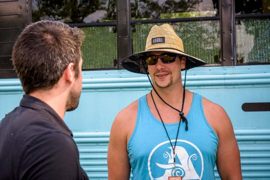 Adam Czap, CEO and founder of Ascension Brewing Company, talks with Free Press editor Brian Manzullo at the 2019 Summer Beer Festival at Riverside Park in Ypsilanti on July 26, 2019.