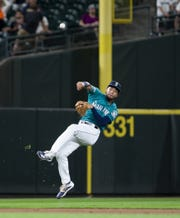 Mariners shortstop J.P. Crawford makes a quick-turn throw to first base to throw out Tigers third baseman Jeimer Candelario to end the top of the ninth inning of the Tigers' 3-2 loss on Friday, July 26, 2019, in Seattle.