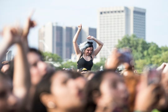 Fans cheer as Wallows performs at the River Stage of Mo Pop Festival at West Riverfront Park in Detroit,   Saturday, July 27, 2019.