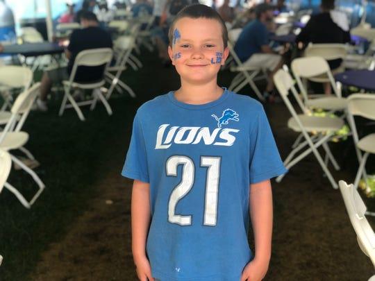 Nine-year-old Xavier Jones loves Matt Stafford, but wore his Reggie Bush shirt to Lions training camp on July 27, 2019 in Allen Park, Michigan.