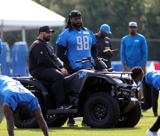 Lions coach Matt Patricia and defensive tackle Damon Harrison talk during training camp on Saturday, July 27, 2019 in Allen Park.