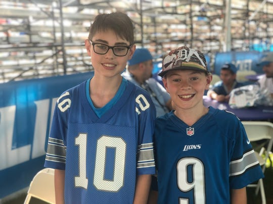 Jacob Kvasnak (left) and brother Colin are not sure who is on the back of the Lions No. 10 jersey. July 27, 2019 at Lions training camp in Allen Park, Michigan.