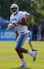 Lions tight end Logan Thomas catches passes during practice during training camp on Saturday, July 27, 2019, in Allen Park.