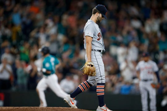 Tigers pitcher Daniel Norris walks off the back of the mound after giving up a two run home run to Mariners catcher Tom Murphy during the seventh inning of the Tigers' 3-2 loss on Friday, July 26, 2019, in Seattle.