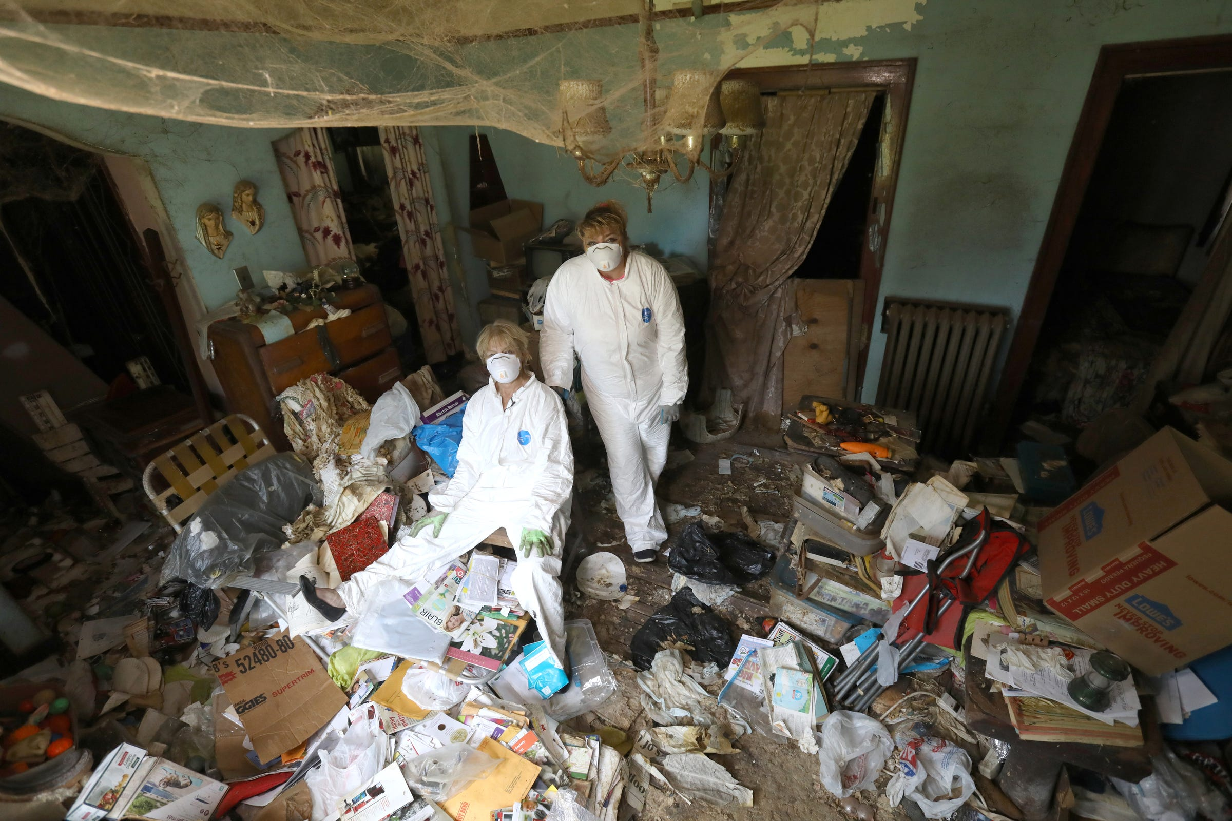 Image result for cleaning up hoarder house