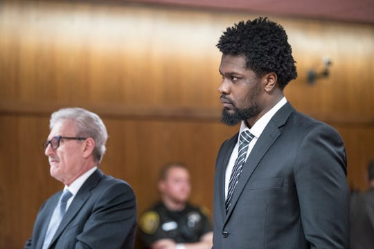 Malik McDowell attends his probation hearing next to his attorney Mitchell Ribitwer at the Oakland County Circuit Court in Pontiac, Wednesday, July 24, 2019.