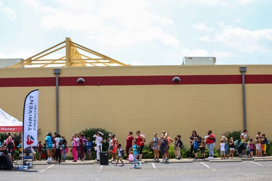 People wait in line at the Samaritan's Feet International and several local partner organizations' event to receive new athletic shoes, socks and school supplies at Cornerstone Church in Wayne, Mich. on Saturday, July 27, 2019.
