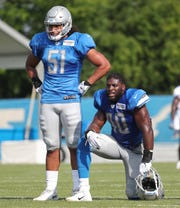 Jahlani Tavai, left, and Jarrad Davis during practice July 27.