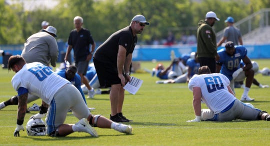 Lions offensive line coach Jeff Davidson talks with Graham Glasgow during practice during training camp on Saturday, July 27, 2019, in Allen Park.