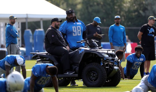Detroit Lions head coach Matt Patricia and DL Damon Harrison talk during training camp Saturday, July 27, 2019 in Allen Park.