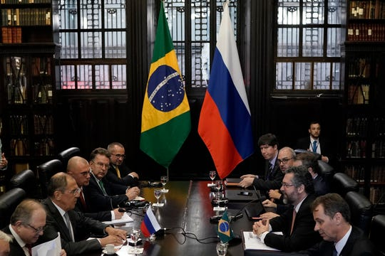 Russia's Foreign Minister Sergey Lavrov, second left, and Brazil's Foreign Minister Ernesto Araujo, second right, take part in a BRICS bilateral meeting in Rio de Janeiro, Brazil, Friday, July 26, 2019. BRICS is a grouping of major emerging economies encompassing Brazil, Russia, India, China and South Africa.