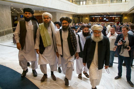 Mullah Abdul Ghani Baradar, the Taliban group's top political leader, third from left, arrives with other members of the Taliban delegation for talks in Moscow, Russia, on May 28.