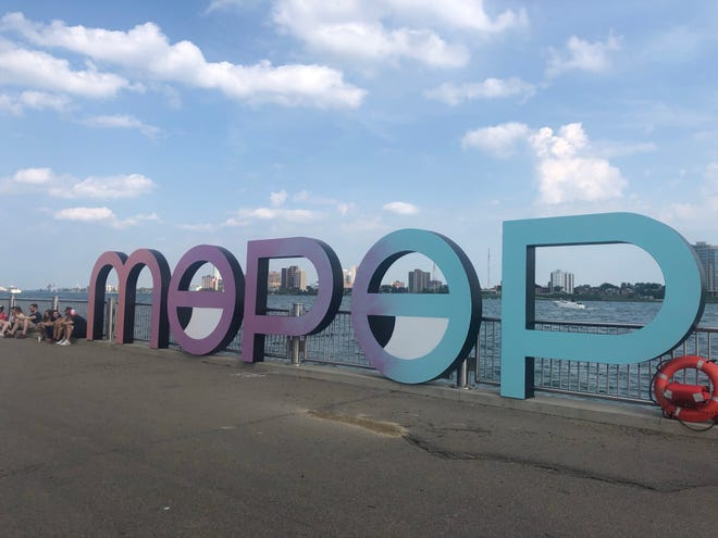 Music fans lined up to take photos with this Mo Pop sign on Detroit's riverfront.