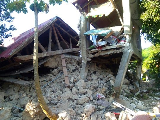 A damaged house remains in Itbayat town, Batanes islands, northern Philippines after a strong earthquake struck on Saturday July 27, 2019. Two strong earthquakes hours apart struck a group of sparsely populated islands in the Luzon Strait in the northern Philippines early Saturday.
