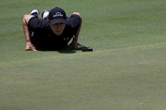 Matthew Fitzpatrick views his putt on the seventh green during the second round of the World Golf Championships-FedEx St. Jude Invitational.