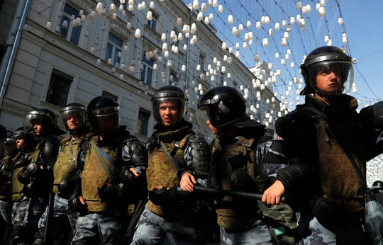 Police block a street during an unsanctioned rally in the center of Moscow, Russia, Saturday.