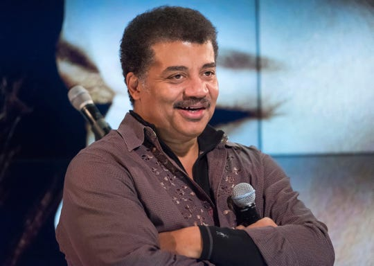 "FILE - In this Nov. 1, 2017 file photo, Neil deGrasse Tyson attends a fan event celebrating the release Kelly Clarkson's album ""Meaning of Life"" at YouTube Space New York in New York."