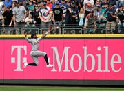 Detroit Tigers right fielder Niko Goodrum leaps, but can't catch a double hit by Seattle Mariners' Tim Beckham during the fifth inning.