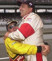 Brett Bodine gets a bear hug from his brother Geoff after setting a track record in qualifying for the Brickyard 400 at the Indianapolis Motor Speedway on Aug. 4, 2000.