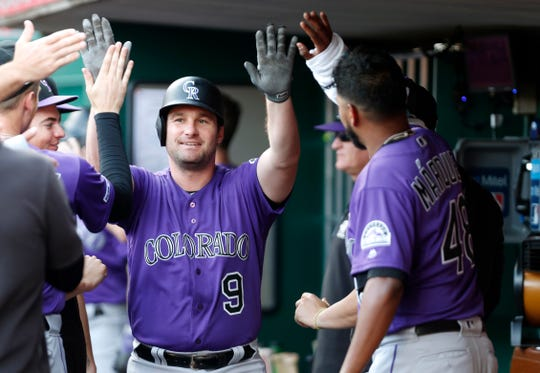 First baseman Daniel Murphy celebrates with teammates after hitting a three-run homer Friday night at Cincinnati. The Rockies return home from a 10-game road trip Monday for a 6:40 p.m. game against the Los Angeles Dodgers at Coors Field in Denver.