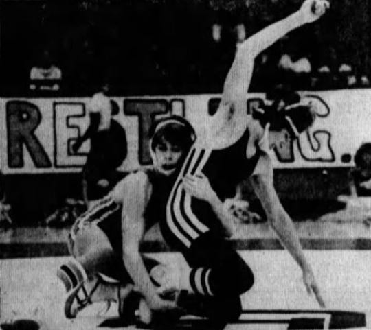 Scott Barrett, left, was a three-time state wrestling champion for Great Falls High from 1976-78.