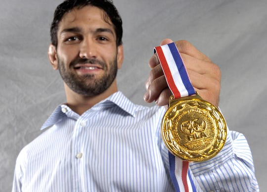 TRIBUNE PHOTO/ROBIN LOZNAK Wrestler Bill Zadick  shows off his gold medal from the 2006 FILA World Championships on Tuesday, Oct. 10, 2006.