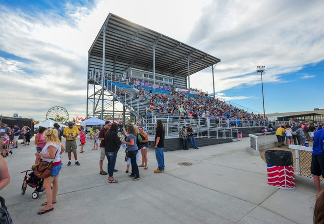 The new Montana ExpoPark grandstands fill up as the horse races get underway at the Montana State Fair on Friday, July 26, 2019.