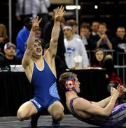 """Great Falls High's Cole Mendenhall holds up """"fours"""" on each hand after earning his fouth state championship title with a win over Buttes Tom Challeen in 2012 at the all-class state wrestling tournament in Billings."""