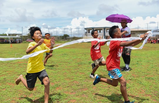 Atlas Atty beats competitors at the finish line during the Kuchu Track and Field event at the Dededo Sports Complex on July 27, 2019.