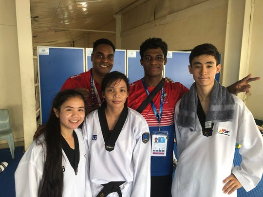 Three of Guam's five taekwondo fighters fought on the second day of competition, and all five earned medals. In white, from left, are Tierra-Lynn Chargualaf (silver), Amber Toves (silver) and Leon Ho (bronze). At rear from left are coach Ron Cook and fighter Alexander Allen (silver). Not pictured is fighter Joseph Ho (bronze) and coach Mike Ho.