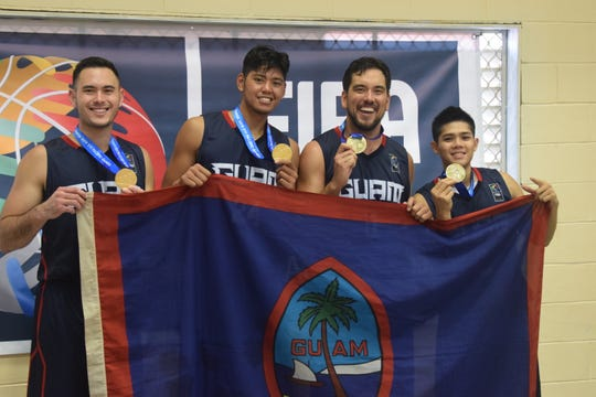 Guam's gold-medal 3X3 basketball team shows their gold medals, and the flag of the island they play for. They are, from left: Mike Sakazaki, Ben Borja, Seve Susuico and A.J. Carlos.