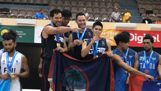 Team Guam captures the gold medal in the first-ever Pacific Games 3X3 Basketball Tournament with a come-from-behind win against Fiji in this file photo from summer 2019. Shown from are Seve Susuico, Ben Borja, Mike Sakazaki and AJ Carlos.