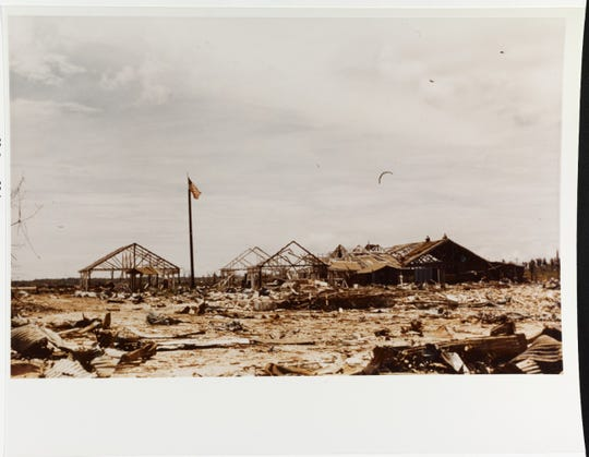 The U.S. Flag waves proudly over the ruins of the Guam Marine Barracks on Orote Peninsula, soon after its recapture from the Japanese on July 29,  1944.