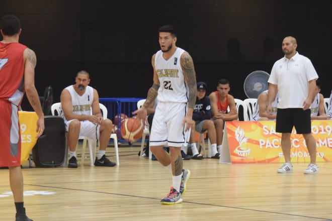 Guam guard Daren Hechanova looks for an opening against an opponent at the XVI Pacific Games in Samoa in this file photo from August 2019. Visible at rear is Mekeli Wesley, left and Guam coach E.J. Calvo. Guam was set to plat in the  FIBA Asia Cup qualification round Feb. 19 and 21 before Bahrain's' government closed its borders.
