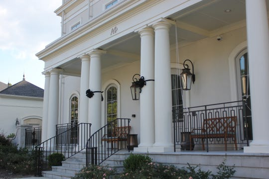 Black ribbons adorn the columns at Alpha Phi sorority at Ole Miss.