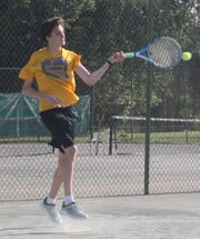 Liam Cummins kicks up some clay as he hits a forehand during the boys 18 finals in the 86th News Journal/Richland Bank Tennis Tournament at Lakewood Racquet Club