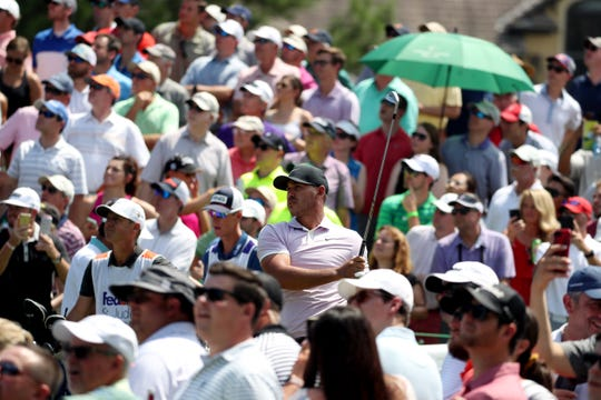 Fans gather around Brooks Koepka at No. 14 during the third round of the WGC-FedEx St. Jude Invitational at TPC Southwind on July 27.