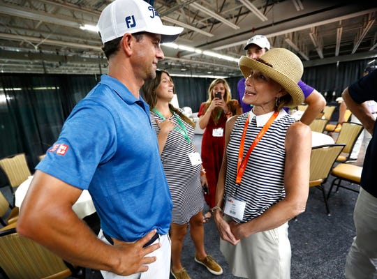 Lisa Yarbro meets her favorite golfer, Adam Scott, in a surprise gathering after his round at the WGC-FedEx St. Jude Invitational at TPC Southwind on Saturday, July 27, 2019. Yarbro, who is a longtime volunteer of the event, was sidelined this year after being diagnosed with a rare form of liver cancer.