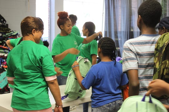 Volunteers hand out backpacks filled with school supplies to students on July 27, 2019 at Mississippi Boulevard Christian Church.