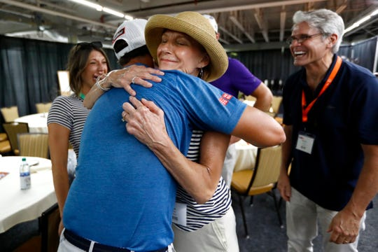 Lisa Yarbro meets her favorite golfer, Adam Scott, during a surprise gathering after his round at the WGC-FedEx St. Jude Invitational at TPC Southwind on Saturday, July 27, 2019. Yarbro, who is a longtime volunteer of the event, was sidelined this year after being diagnosed with a rare form of liver cancer.