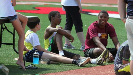 R.J. Graddy volunteered with the Madison youth track and field program.