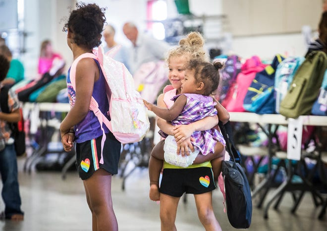 Hundreds of families lined up at the Delaware County Fairgrounds so their children could receive a free backpack full of school supplies and a new pair of shoes during the annual Tools for School event Saturday morning. Students from preschool through 12th grade were eligible to receive supplies.