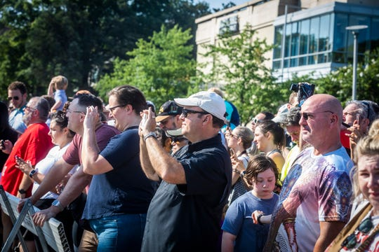 People gather at the intersection of 25th Avenue and West End to see Vanderbilt & # 39; s Carmichael West Tower 3 be imploded on Saturday, July 27, 2019.