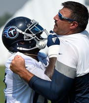 Titans tight end Delanie Walker (82) blocks head coach Mike Vrabel during practice at Saint Thomas Sports Park Saturday, July 27, 2019, in Nashville, Tenn.
