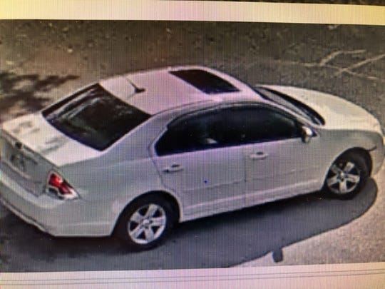 Police are looking for a second man who fled in a white Ford sedan with a sunroof. He is wanted for questioning.